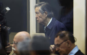 Former President Alberto Fujimori arrives to testify in a courtroom at a military base in Callao, Peru, Thursday, March 15, 2018. Fujimori testified at the trial charging his former intelligence chief of ordering the kidnapping of Peruvian journalist Gustavo Gorriti in 1992. (AP Photo/Martin Mejia)