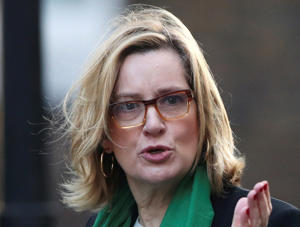 Britain's Home Secretary Amber Rudd arrives in Downing Street in London