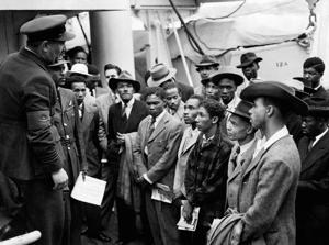 File photo dated 22/06/48 of Jamaican immigrants being welcomed by RAF officials from the Colonial Office after the ex-troopship HMT Empire Windrush landed them at Tilbury.