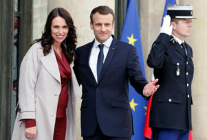 French President Emmanuel Macron welcomes New Zealand's Prime Minister Jacinda Ardern (L) prior to their meeting at the Elysee Palace on April 16, 2018 in Paris. Ardern is in Paris for a one-day visit.