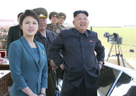 North Korean leader Kim Jong Un (R) stands next to his wife Ri Sol Ju as they attend the 2014 Combat Flight Contest among commanding officers of the Korean People's Air Force in this undated photo released by North Korea's Korean Central News Agency (KCNA) in Pyongyang May 10, 2014. REUTERS/KCNA (NORTH KOREA - Tags: POLITICS MILITARY TRANSPORT) ATTENTION EDITORS - THIS PICTURE WAS PROVIDED BY A THIRD PARTY. REUTERS IS UNABLE TO INDEPENDENTLY VERIFY THE AUTHENTICITY, CONTENT, LOCATION OR DATE OF THIS IMAGE. FOR EDITORIAL USE ONLY. NOT FOR SALE FOR MARKETING OR ADVERTISING CAMPAIGNS. THIS PICTURE IS DISTRIBUTED EXACTLY AS RECEIVED BY REUTERS, AS A SERVICE TO CLIENTS. NO THIRD PARTY SALES. NOT FOR USE BY REUTERS THIRD PARTY DISTRIBUTORS. SOUTH KOREA OUT. NO COMMERCIAL OR EDITORIAL SALES IN SOUTH KOREA - GM1EA5A1DYB01