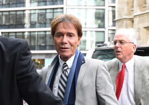 Sir Cliff Richard (centre) arrives at the Rolls Building in London for the continuing legal action against the BBC over coverage of a police raid at his apartment in Berkshire in 2014