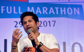 Former Indian cricketer Sachin Tendulkar gestures as he attends a programme to promote a full marathon, in Kolkata on January 28, 2017. / AFP / Dibyangshu SARKAR        (Photo credit should read DIBYANGSHU SARKAR/AFP/Getty Images)