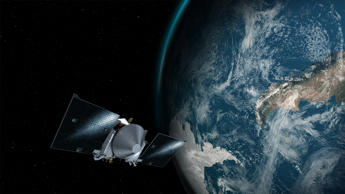 This illustration provided by NASA depicts the OSIRIS-REx spacecraft and the Earth.