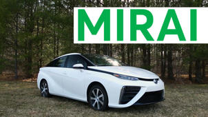 a car parked in front of a sign: 2016 Toyota Mirai Road Test