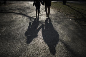 BERLIN, GERMANY - FEBRUARY 25: The shadow of a walking couple is pictured on February 25, 2018 in Berlin, Germany. (Photo by Florian Gaertner/Photothek via Getty Images)