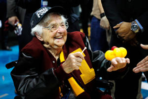 Sister Jean Dolores Schmidt celebrates with the Loyola Ramblers after defeating the Kansas State Wildcats during the 2018 NCAA Men's Basketball Tournament South Regional at Philips Arena on March 24, 2018 in Atlanta, Georgia.
