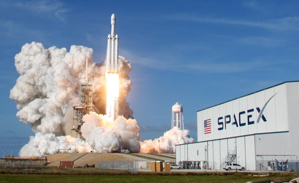 Slide 1 of 20: A SpaceX Falcon Heavy rocket lifts off from historic launch pad 39-A at the Kennedy Space Center in Cape Canaveral, Florida, U.S., February 6, 2018. REUTERS/Thom Baur TPX IMAGES OF THE DAY