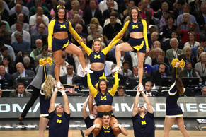 The Michigan Wolverines cheerleaders perform in the first half during the 2018 NCAA Men's Final Four Semifinal between the Michigan Wolverines and the Loyola Ramblers at the Alamodome on March 31, 2018 in San Antonio, Texas.