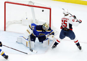 Washington Capitals' Andre Burakovsky, right, scores past St. Louis Blues goaltender Jake Allen during the second period of an NHL hockey game Monday, April 2, 2018, in St. Louis. (AP Photo/Jeff Roberson)