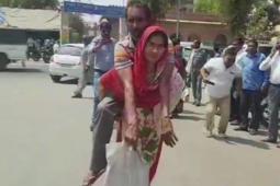 Woman forced to carry differently-abled husband on back