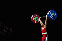 GOLD COAST, AUSTRALIA - APRIL 05:  Gold medalist, Chanu Saikhom Mirabai of India competes during the Weightlifting Women's 48kg Final on day one of the Gold Coast 2018 Commonwealth Games at Carrara Sports and Leisure Centre on April 5, 2018 on the Gold Coast, Australia.  (Photo by Dean Mouhtaropoulos/Getty Images)