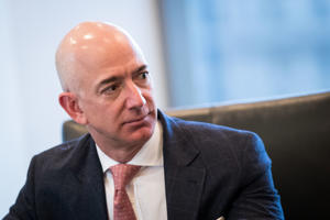 Jeff Bezos, chief executive officer of Amazon, listens during a meeting of technology executives and the-President-elect Donald Trump at Trump Tower in 2016 in New York City.