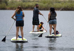 JEFFERSON COUNTY, CO - MAY 25: The Dean family from left to right, Jaden, (daughter) Seth, (dad) Jaxon, (son) and Samantha, (mom) head out on a stand-up paddle board trip at Chatfield Reservoir May 25, 2017 in Jefferson County. (Photo by Andy Cross/The Denver Post via Getty Images)