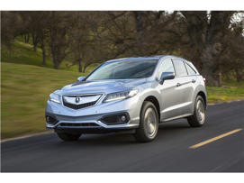 a car parked on the side of a road: 2016 Acura RDX