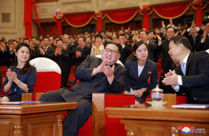 In this Monday, April 16, 2018, photo provided Tuesday, April 17, 2018, by the North Korean government, North Korean leader Kim Jong Un, claps while watching a performance of a Chinese art troupe with his wife Ri Sol Ju, left, and Song Tao, right, head of the ruling Communist Party's International Department, at East Pyongyang Grand Theater in Pyongyang, North Korea.