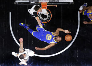 Golden State Warriors' Kevin Durant (35) is thrown back attempting to score against San Antonio Spurs' Pau Gasol, top, and forward LaMarcus Aldridge, bottom, during the second half of Game 3 of a first-round NBA basketball playoff series in San Antonio, Thursday, April 19, 2018. (AP Photo/Eric Gay)