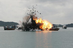 Indonesian Navy blows up 6 foreign fishing vessel caught fishing illegally in Batam.