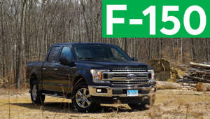 a car parked in front of a truck: 2018 Ford F-150 Road Test