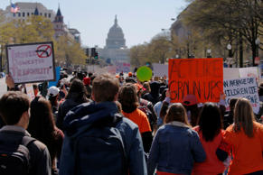 Students march to the U.S. Capitol, as part of a nationwide walk-out of classes to mark the 19th anniversary of the Columbine High School mass shooting, in Washington, DC, U.S., April 20, 2018.