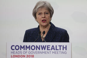 Britain's Prime Minister Theresa May addresses the closing press conference of the Commonwealth Heads of Government Meeting (CHOGM), at Marlborough House in London on April 20, 2018