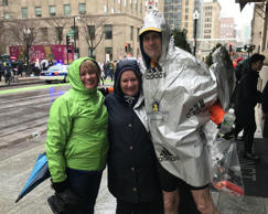 John Fisher celebrates with his wife, Tammy, center, and sister, Ruth Ann Miller after completing the Boston Marathon Monday afternoon. By finishing the Boston race, has completed marathons in all 50 states.