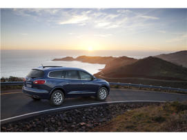 a car parked on the side of a road: 2016 Buick Enclave