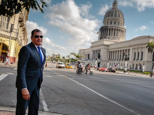 Ecuadoran former President Rafael Correa, walks across a street in Havana, on April 20, 2018. (Photo by ADALBERTO ROQUE / AFP)        (Photo credit should read ADALBERTO ROQUE/AFP/Getty Images)