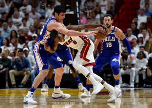 Apr 21, 2018; Miami, FL, USA; Miami Heat forward Josh Richardson (0) fouls Philadelphia 76ers forward Ersan Ilyasova (23) during the first half in game four of the first round of the 2018 NBA Playoffs at American Airlines Arena.