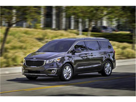a car parked on the side of a road: 2018 Kia Sedona