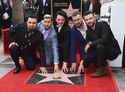 Slide 1 dari 34: Chris Kirkpatrick, from left, Lance Bass, JC Chasez, Joey Fatone and Justin Timberlake of the band NSYNC appear at a ceremony honoring them with a star on the Hollywood Walk of Fame on Monday, April 30, 2018, in Los Angeles.