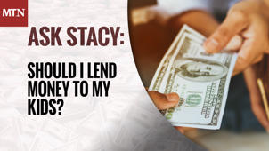 a close up of a newspaper: Should I Lend Money to My Kids?