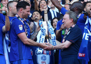 6th May 2018, Cardiff City Stadium, Cardiff, Wales; EFL Championship Football, Cardiff City versus Reading; Sean Morrison of Cardiff City and Neil Warnock, Manager of Cardiff City enjoy the moment with the cup  (Photo by Nathan Munkley/Action Plus via Getty Images)