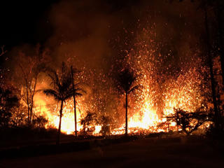 A new fissure spraying lava fountains as high as about 230 feet (70 m), according to United States Geological Survey, is shown from Luana Street in Leilani Estates subdivision on Kilauea Volcano's lower East Rift Zone in Hawaii, U.S., May 5, 2018. Photo taken May 5, 2018.
