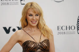 Australian singer Kylie Minogue poses during a photocall upon arrival for the 2018 Echo Music Award ceremony in Berlin, Germany April 12, 2018.  Axel Schmidt/Pool via Reuters