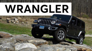 a car parked in front of a rock: 2018 Jeep Wrangler Road Test