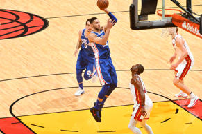 MIAMI, FL - APRIL 21: Ben Simmons #25 of the Philadelphia 76ers shoots the ball against the Miami Heat in Game Four of Round One of the 2018 NBA Playoffs on April 21, 2018 at American Airlines Arena in Miami, Florida. NOTE TO USER: User expressly acknowledges and agrees that, by downloading and or using this Photograph, user is consenting to the terms and conditions of the Getty Images License Agreement. Mandatory Copyright Notice: Copyright 2018 NBAE (Photo by Jesse D. Garrabrant/NBAE via Getty Images)