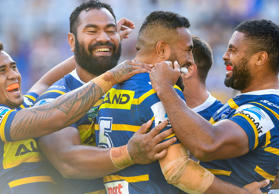 Michael Jennings (right) for the Eels celebrates with team mates after scoring a try