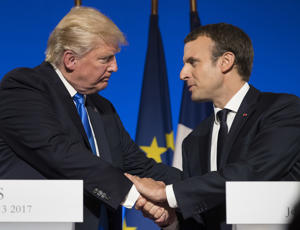 President Donald Trump and French President Emmanuel Macron shake hands at the conclusion of a joint news conference at the Elysee Palace in Paris, Thursday, July 13, 2017.