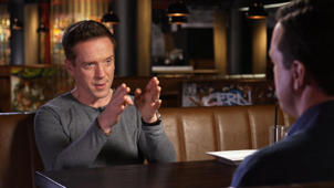 Damian Lewis sitting at a table: British actor Damian Lewis reveals how he got his New York accent for 'Billions'