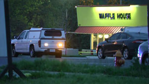 a car parked on the side of a road: Shooting at a Tennessee Waffle House leaves at least 4 dead