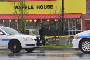 Law enforcement stand outside a Waffle House where four people were killed and two were wounded after a gunman opened fire with an assault weapon on April 22, 2018 in Nashville, Tennessee.