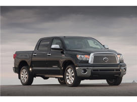 a car parked on the side of a road: 2011 Toyota Tundra