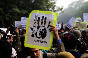 NEW DELHI, INDIA  DECEMBER 27, 2012: Students take part in a rally held at India Gate to protest against Delhi gang rape. (Photo by Pradeep Gaur/Mint via Getty Images)