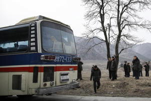 North Koreans who were travelling in a bus, stop at the side of a highway for a break in Koksan county in North Hwanghae province, North Korea.