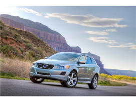 a car driving on a mountain road: 2012 Volvo XC60