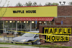 Police tape blocks off a Waffle House restaurant on Sunday, April 22, 2018, in Nashville, Tenn. At least four people died after a gunman opened fire at the restaurant early Sunday.