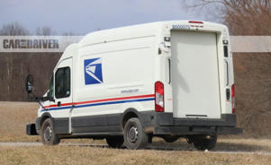 a truck is parked on the side of a road: Ford Transit mail truck (spy photos)
