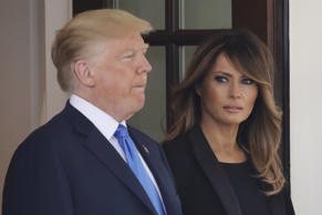 First lady Melania Trump looks over at U.S. President Donald Trump as they wait at the West Wing door to welcome French President Emmanuel Macron and his wife Brigitte Macron at the White House in Washington, U.S., April 23, 2018