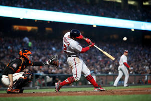 SAN FRANCISCO, CA - APRIL 23:  Howie Kendrick #12 of the Washington Nationals hits a sacrifice fly that scored Trea Turner #7 in the third inning against the San Francisco Giants at AT&T Park on April 23, 2018 in San Francisco, California.  (Photo by Ezra Shaw/Getty Images)